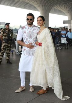 Colour Coordinated Again, Deepika Padukone And Ranveer Singh Fly To Bengaluru is part of Kurta men - Needless to say Deepika Padukone, Ranveer Singh stepped out in Sabyasachi couture, who is their designated wedding designer are a vision in white Sherwani For Men Wedding, Wedding Dresses Men Indian, Wedding Dress Men, Wedding Men, Sherwani Groom, Mens Sherwani, Punjabi Wedding, Indian Weddings, Farm Wedding