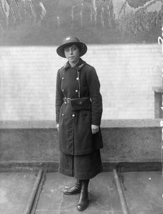 female GPO (General Post Office) telegraph messenger. not dated. Horace Nicholls. IWM Q 30362.
