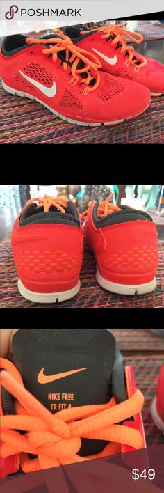 Women's Nike TR Fit 4 Training Shoe in Red/ Orange Like new condition. Used once. Color: red/ orange or deep coral with orange straps. They definitely make a statement! Nike Shoes Sneakers