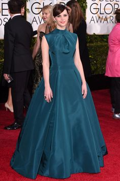 The Golden Globes' Most Stunning Red Carpet Moments #refinery29  http://www.refinery29.com/2015/01/80582/golden-globes-2015-red-carpet-best-dressed-celebrities#slide-27  Felicity Jones There's something incredibly romantic about Felicity Jones' turquoise Dior couture dress. With a high neck and subtle pleating, it's got a timeless quality that would have made it as elegant 50 years ago as it is now.