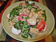 Quinoa and tempeh salad with chickpeas, radish, tomato, chicory, rocket, baby spinach, and basil.