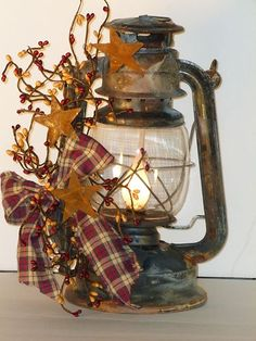 Cute lantern. Can change the ribbons, foliage, ect to reflect the time of year and décor needed. This would be nice decorated for Christmas.