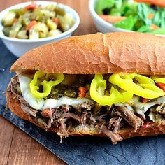 Crock Pot Italian Beef Sandwiches are the 5-ingredient crock pot version of the popular hot sandwich recipe. This easy dinner recipe is a crowd-pleaser!
