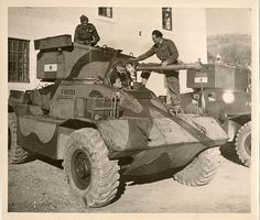 https://flic.kr/p/8BX4f9 | Allied Aid To Yugoslav Partisans | British armored cars, American tanks, anti-tank guns, and other equipment suitable for mountainous warfare are being supplied to Marshal Tito's Yugoslav partisans for use against German forces trapped in Yugoslavia.  Dec. 1944  Vehicle in the pic appears to be a re-badged Brit AEC Armoured Car
