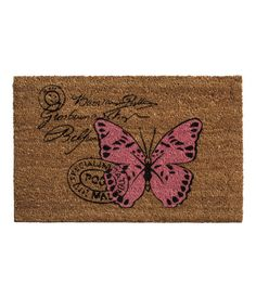 Doormat in coir with a printed motif and latex backing. Size 18 x 28 in.