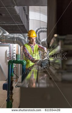 Worker making final touches to HVAC system. HVAC system stands for heating, ventilation and air conditioning technology. Cool Rooms, Conditioning, Indoor, Concept, Technology, Cool Stuff, Decor, Pictures, Interior
