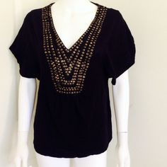 H&M black embellished bib top Size Small Soft black bib top from H&M Size small. Has gold beads on the front and flutter sleeves. Has a little hole on the shoulder than can be sewn easily as it's on the hem-- just want to be totally transparent! H&M Tops Blouses