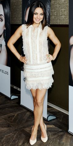 Mila Kunis wore an Elie Saab white collared lace cocktail dress with tiered skirt detail.