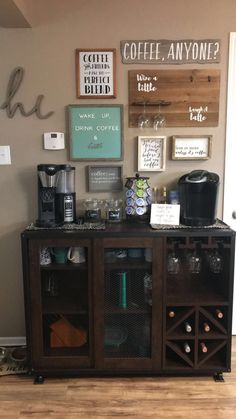 The one design of the coffee bar is designed quite simply with a wooden table in which there is room for storing coffee powder, cups and other coffee cups