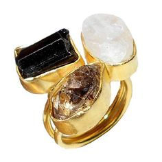 Gold-plated Brass Rough Cut Herkimer Diamond, Tourmaline and Rainbow Moonstone Adjustable Ringhttps://sitaracollections.com/collections/handmade-rings/products/gold-plated-herkimer-diamond-tourmaline-and-rainbow-moonstone-adjustable-ring