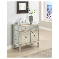 The Mirrored Console is the perfect compliment to your home. Featuring one drawer and two doors, this piece provides ample storage space with an interior, fixed shelving unit. The grey wood and mirror surfaces are highly adaptable to any homes decor. The unique details are eye catching, enduring, and are sure to enhance any space. Fully assembled.