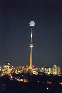We ate dinner in the CN Tower at the revolving restaurant. Not a hue fan of Toronto in general.Full moon over CN Tower, Toronto, Canada Torre Cn, Places Around The World, The Places Youll Go, Places To Visit, Around The Worlds, Ontario, Myconos, Shoot The Moon, Beautiful Moon