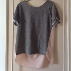 Sparkle sweatshirt Top The front of the shirt is a gray sparkle sweatshirt material. The back is light pink and sheer. The sleeves are short and rolled.  This can be dressed up with a great necklace or worn with a pair of boyfriend jeans. American Eagle Outfitters Tops Sweatshirts & Hoodies