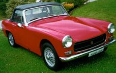 MG Midget--my first car. I miss it!!! I want another one, please. ;)