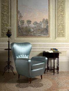 Elegant light blue satin for the revival of an original Italian winggback armchair from the fifties to create your perfect, cosy, stylish reading corner
