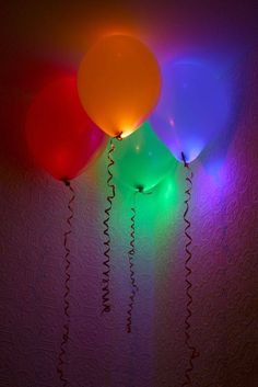 Fill balloons (white or colored) with glow sticks for an awesome party decoration, or just as a fun past time for the kids. After your balloons are half filled with air, carefully insert a glow stick or two, and then finish blowing them up and tying them off. These would be cool hung upside down from the ceiling!