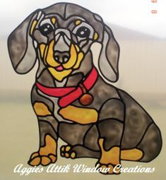 Daschund Puppy - faux leadlight window cling / decal. Hand painted using gallery glass paints for a stained glass effect. I used an intarsia wood pattern for this design.