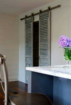 Sliding shutters over a glass door instead of curtains that get in the way!