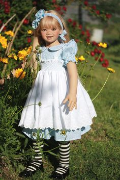 A doll named Milla, created by Annette Himstedt, wears a white apron, long blond hair #Himstedt #doll