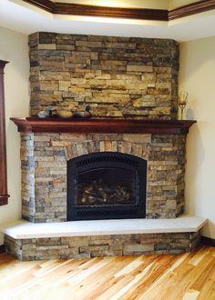 Corner fireplace - cherry mantle, Millbrook ledge stone