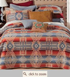 Beautiful, vintage looking 'Camp-Cottage-Western' bedding on this site. Perfect for eclectic camp mix. Picture Polo cabbage roses, ticking stripes and plaids in the mix. Mmmm.