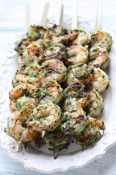 Grilled Pesto Shrimp Skewers from Skinnytaste: so good!, I used jar pesto and grilled the shrimp in a cast iron skillet over campfire. Will make again w/fresh pesto for sure! Yummy Recipes, Fish Recipes, Seafood Recipes, Cooking Recipes, Healthy Recipes, Basil Recipes, Recipies, Water Recipes, Cooking Food