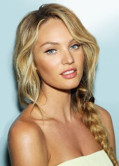 Love the hairstyle. A little wavy on the top and a side braid. This would be great for summer or going to the beach!