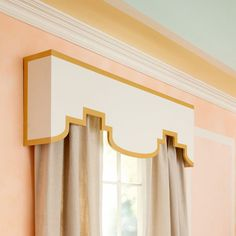 Nice modern taken on a traditional window dressing - Moroccan-style valance in white and gold