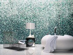 ... the colors of the ocean in stunning mosaic patterns in this bathroom