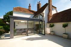 Glass extension with a sliding pocket door to retain warmth in winter