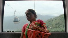 Produced by the directors of Sweetgrass and Leviathan, MANAKAMANA, is an exhilarating, one-of-a-kind documentary experience. Filmed entirely inside the narrow confines of a cable car, high above a jungle in Nepal, that transports villagers to an ancient mountaintop temple, it is an acute ethnographic investigation into culture, religion, technology and modernity.