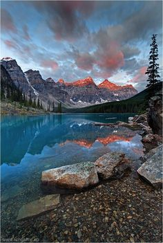 Moraine Lake is located in the Valley of the Ten Peaks at an elevation of 1885 m (6184 ft). The ten peaks tower 1200 to 1500 m (4900 ft) above the lake building a continuous ridge of 12 km (7.5 miles) length. The mountains consist of four sediment formations that lie flat on top of each other from old to young. The prominent change in the rock color from reddish brown to gray separates the Gog quartzite from the overlying Cathedral formation. The quartzite is up to 600 million years old and…