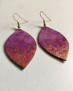 •LEATHER LEAF EARRINGS• Purple suede leather is hand cut in the shape of a leaf and hangs from a nickel free earwire. Then the suede is accented with magenta pink and metallic gold acrylic paint. The pain is sealed for added protection. These earrings are simplistic but make a big