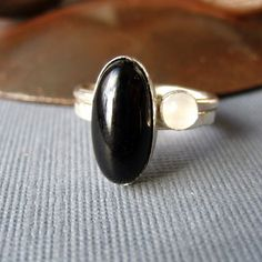 Black onyx white moonstone sterling silver stacking ring pair.