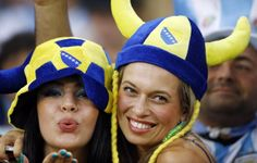 Fans pose before the start of the group F World Cup soccer match between Argentina and Bosnia at the Maracana Stadium in Rio de Janeiro, Brazil, Sunday, June 15, 2014. (Photo by Kirsty Wigglesworth/AP Photo)