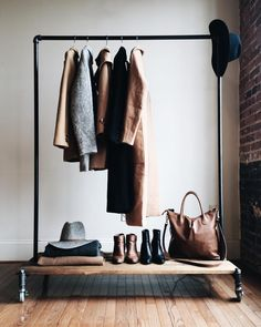 """""""My Wardrobe Staples.   I'm so grateful for my @monroetrades minimalist closet rack. It will fit perfectly into our new space + will be wonderfully useful…"""""""
