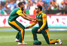 South Africa v India, 13th Match, Pool B Imran Tahir and Faf du Plessis celebrate the dismissal of Virat Kohli.
