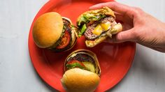 Juicy Lucy Sliders. We're obsessed with Juicy Lucys, cheese-filled burgers that originated in Minnesota. Here's our recipe for sliders—appetizers that you can make super-decadent by melting some butter in the skillet before toasting the potato rolls.