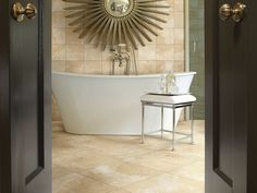 Vicenza from Shaw- subtle yet dramatic travertine visual. A gorgeous tub and sunburst mirror complete the look. Oh my @Cheapcarpets - www.thecarpetstore.org