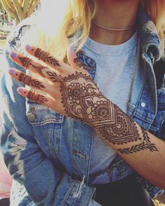 mehndi design tattoo on hand