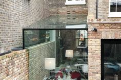 Browse images of modern Conservatory designs: Side Return Frameless Glass Extension. London. Find the best photos for ideas & inspiration to create your perfect home.