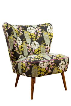 Part of a collection launched in March 2015 in collaboration with multi-award winning illustrator and surface pattern designer Abigail Borg - www.abigailborg.com  In stock ready for delivery.  An original vintage cocktail chair covered in Abigail Borgs beautiful illustrative botanical fabric Polka Polka. Polka Polka is characterised by a bold Bougainvillea design trailing around Red Hot Polkas on a twilight black fabric. - Expertly reupholstered by our Long Eaton based team using a mix of…