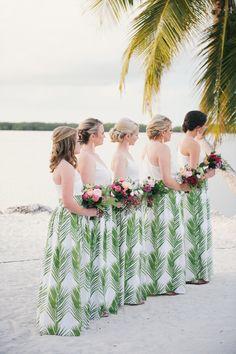 Floral Design : Anthology Florist | Bridesmaids Dresses : Katie Kime skirts | Photography : Still55 Photography Read More on SMP: http://www.stylemepretty.com/florida-weddings/florida-keys/islamorada/2017/01/26/a-destination-wedding-that-embraces-bold-island-color/