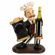 """Multicolor chef statue wine rack with a chalkboard accent.  Product: Wine rackConstruction Material: Polystone and chalkboardColor: MultiFeatures: Holds a chalkboard in one handHolds one bottle of wine in the other handDimensions: 20"""" H x 13"""" W x 9"""" D"""