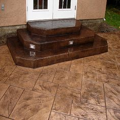 Stamped concrete patio with steps