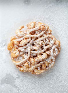 Mini Funnel Cakes Recipe | The Southern Tailgating Cookbook (Remember when you were a kid and would beg your parents for a funnel cake at the state fair? Now you can have as many as you want.)
