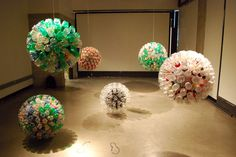 "American artist Bart Vargas's Bart Vargas's ""Bottleballs,"" salvaged plastic bottles glued onto cardboard globes. from Unconsumption – Page 9"