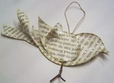 Have some old book pages, sheet music, or scrapbook paper? Make this pretty Recycled Bird Ornament! Origami Christmas Ornament, Unique Christmas Ornaments, Bird Ornaments, Paper Ornaments, Christmas Tree Decorations, Christmas Art, Diy Projects With Books, Art Projects, Bird Book