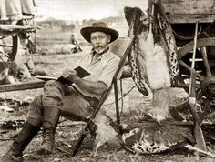Explorer Frederick Courtenay Selous in Africa with his Holland and Holland rifle and two shot large bustards, c. 1890