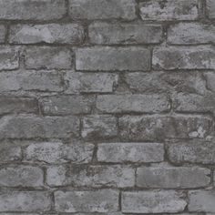 Town Brick (31284) - Albany Wallpapers - A photo style image of a weather brick wall with a smooth texture. Shown in the silvered charcoal black colourway - other colours available. Please request a sample for true colour match.